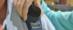 Industrial Hygienists place noise dosimeters on factory employees to monitor employee exposure to noise levels.